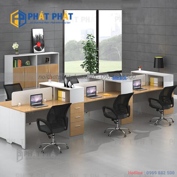 Tác dụng tuyệt vời của bàn văn phòng có vách ngăn trong không gian làm việc.